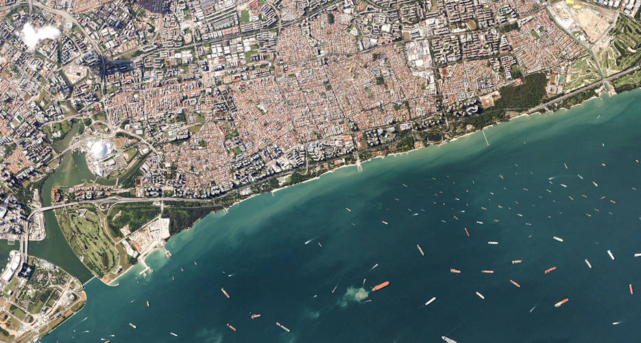 A ship leaves or arrives in the Port of Singapore every three minutes. Keeping the congested waters off the port safe while keeping tabs on what passes through is a tall order. Recurrent images of the port help, but using human eyes to inspect the images is time-consuming and difficult. Programming image software to count ships in seconds unlocks more possible uses for the data; Planet develops some tools like this, and outside companies also contract with Planet customers to analyze image data algorithmically. (Image courtesy of Planet - 2018)