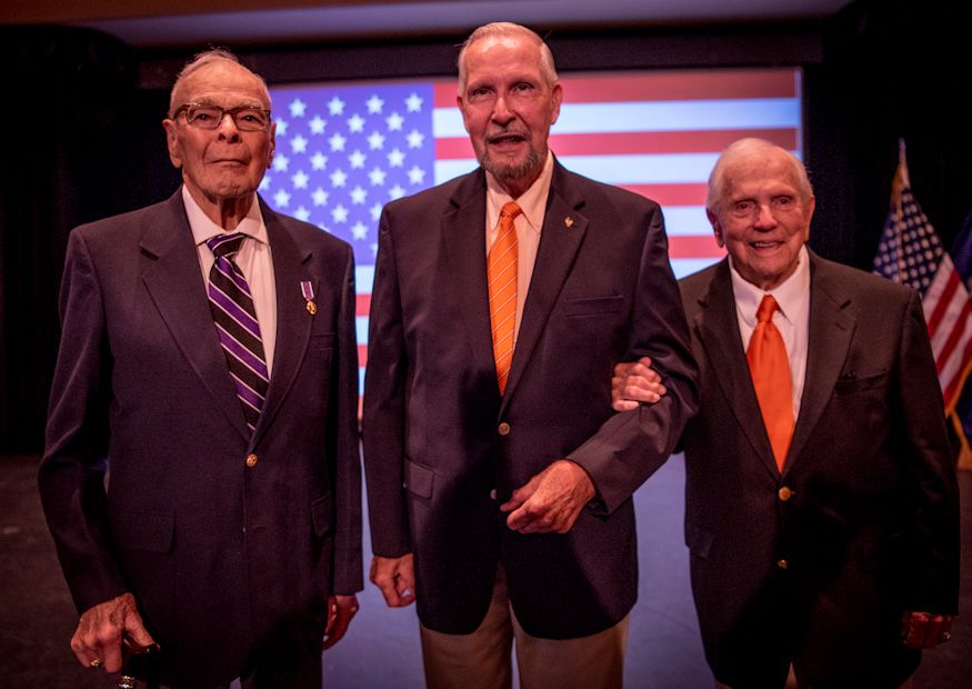 October 4, 2018 - Retired U.S. Army Col. Ben Skardon, 101, (right) a survivor of the Bataan Death March and 1,255 days as a prisoner of war, Army 1st Lt. William Funchess, 90, (left) a survivor of 1,038 days as a POW in the Korean war, and Air Force Col. Bill Austin, 80, (center), an F-4 Phantom pilot who was shot down on his 81st mission ever Vietnam and survived 1,986 days as a POW, chat during a POW/MIA recognition ceremony at Clemson University. All three men are Clemson alums. The ceremony was held by Clemson's Air Force ROTC. (U.S. Army Cadet Command photo by Ken Scar)