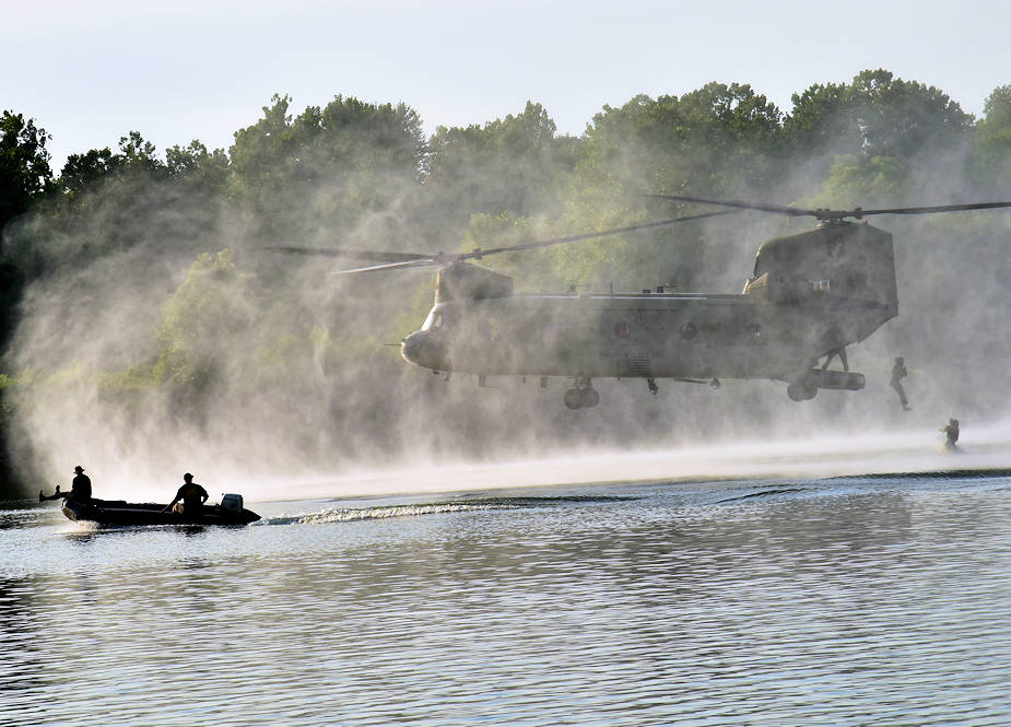 U.S. Soldiers assigned to the 420th Engineer Brigade conduct a helocast drop in the Arkansas River near Fort Chaffee, Arkansas, July 22, 2018, as part of River Assault 2018, a joint training exercise featuring Army Reserve, National Guard, and active Army elements. The helocast event was supported by members of the Sapper Leader Course and the U.S. Army Deep Sea Dive Team. (U.S. Army photo by 1st Sgt. Daniel Griego)
