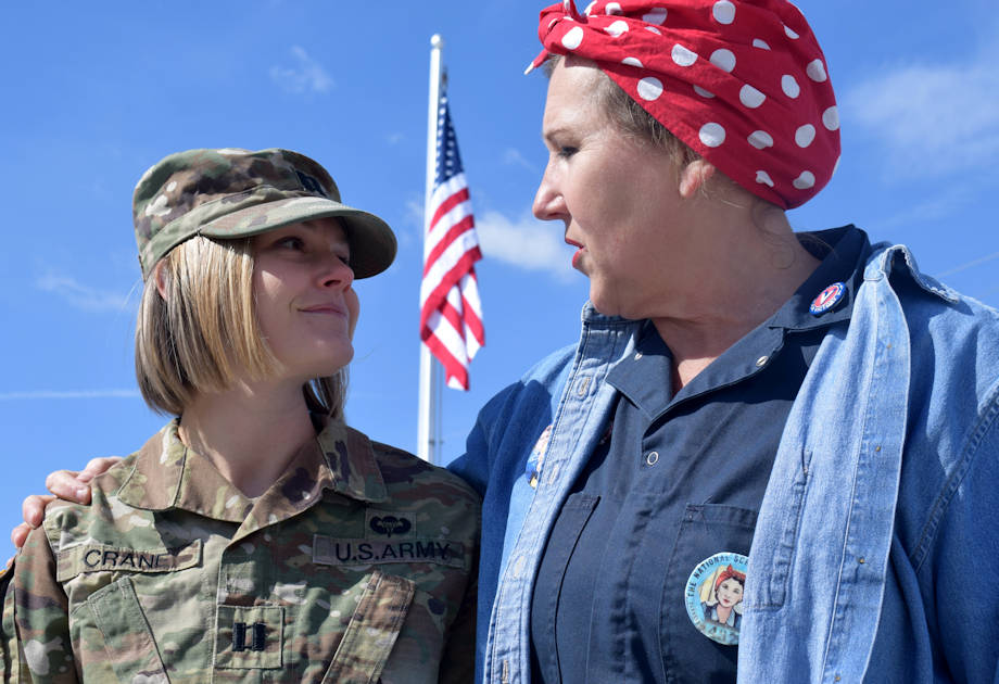 """Angie Timan (right) speaks to Capt. Amy Crane (left), a Soldier stationed at Crane Army Ammunition Activity, during a Rosie the Riveter Memorial Rose Garden Dedication Ceremony in Bedford, Ind., March 21. Tilman coordinated the event to honor the local """"Rosies"""" with a Living Memorial. (Photo by Hayley Smith, Crane Army Ammunition Activity)"""