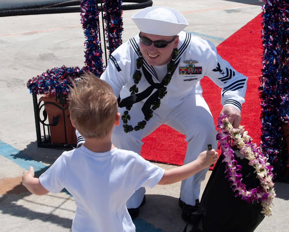 May 14, 2018 - A happy sailor prepares to embrace his little son running to him upon his disembarkment off the Arleigh Burke-class guided-missile destroyer USS Halsey (DDG 97) after its return to homeport, Joint Base Pearl Harbor-Hickam from a seven-month deployment to the U.S. 5th and 7th Fleet areas of operations as part of the Theodore Roosevelt Carrier Strike Group (TRCSG). (U.S. Navy photo by Aviation Electrician Technician Airman Joshua Markwith)