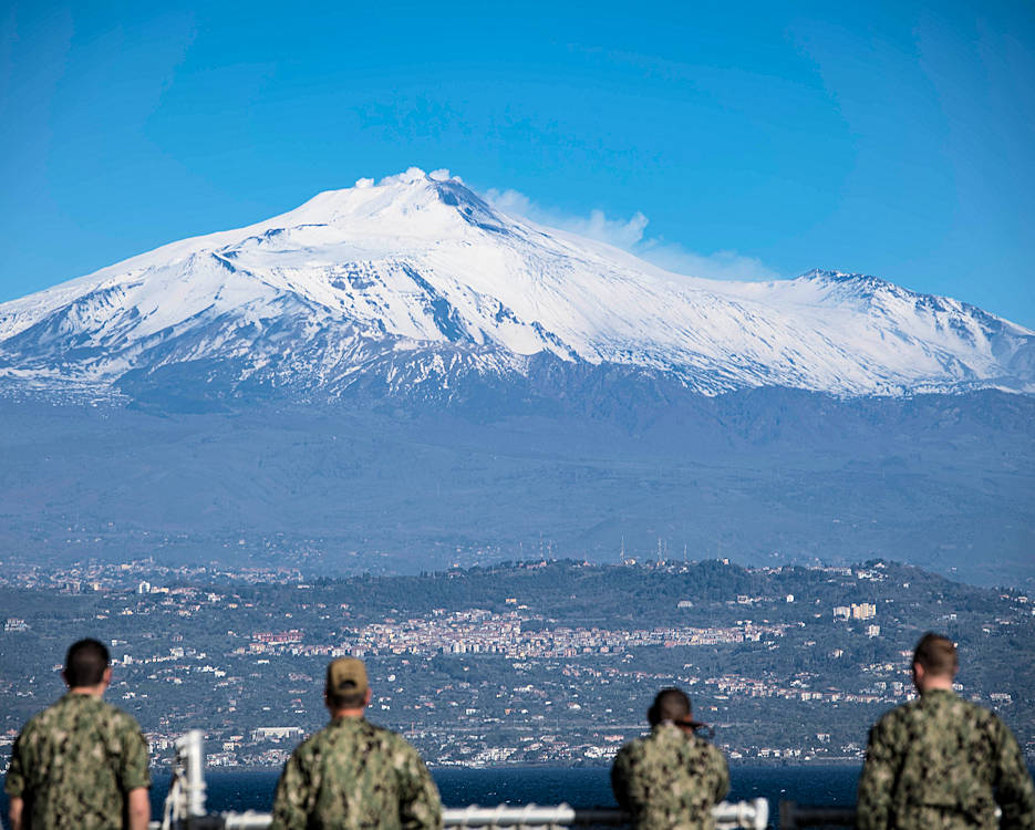 March 7, 2018 - Sailors aboard the Spearhead-class expeditionary fast transport ship USNS Carson City (T-EPF 7) observe Mount Etna as the ship arrives in Catania, Italy. Carson City is conducting naval operations in the U.S. 6th Fleet area of operations to advance security and stability in the region. (U.S. Navy photo by Mass Communication Specialist 3rd Class Ford Williams)