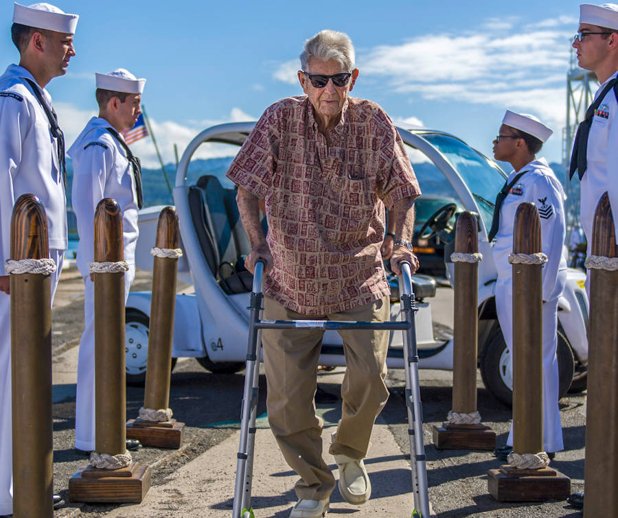 June 19, 2018 - Sailors render honors to retired Chief Petty Officer Ray Emory, a Pearl Harbor survivor, during a farewell ceremony before he departs Hawaii. Emory was responsible for the identification of unknown service members killed in the attacks on Pearl Harbor who were buried in unnamed graves. (U.S. Navy Photo by Petty Officer 2nd Class Justin Pacheco)