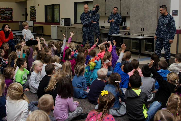 November 21, 2017 - Capt. Jeff Farah, commanding officer of the submarine tender USS Frank Cable (AS 40), and members of his crew  interact with students from Captain Strong Primary School in Battle Ground, Washington. Frank Cable, currently in Portland, Ore. for a scheduled dry-dock phase maintenance availability, conducts maintenance and support of submarines and surface vessels in the Indo-Asia-Pacific region. (U.S. Navy photo by Mass Communication Specialist Mass Communication Specialist Heather C. Wamsley)