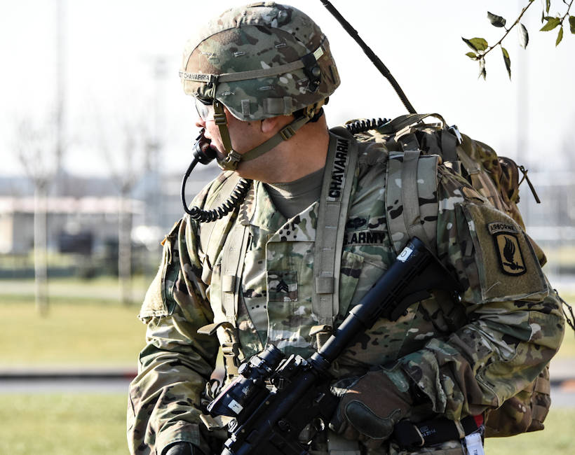 A U.S. Army sergeant communicates with his platoon as they move tactically through an urban environment in Italy during January 10, 2018. The Water Purification Platoon from the Brigade Support Battalion, 173rd Airborne Brigade is conducting a reconnaissance to secure a source of water for the Sky Soldiers. (U.S. Army photo by Lt. Col. John Hall)