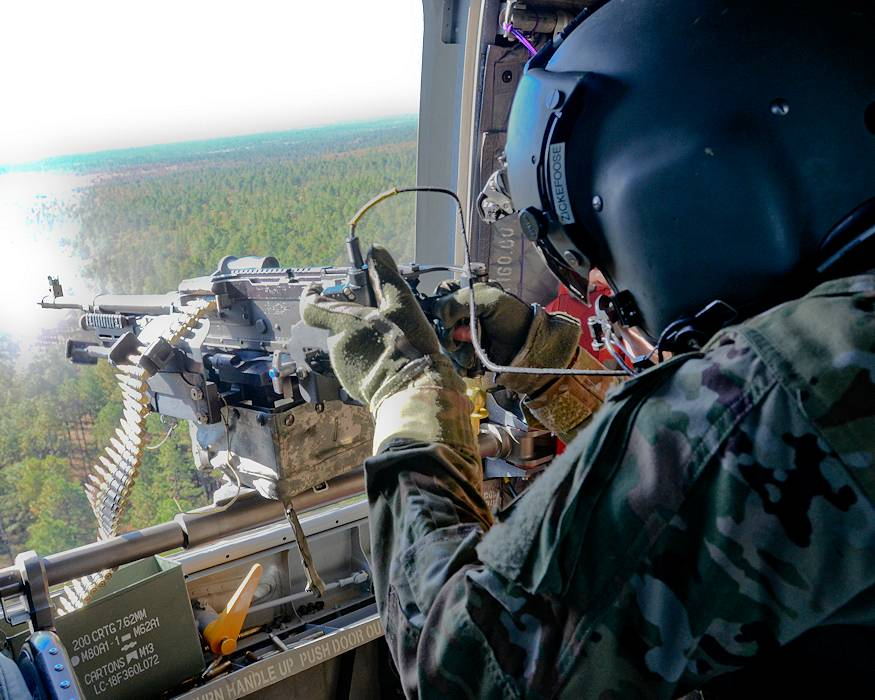 November 7, 2018 - U.S. Army Spc. Cody Zickefoose, a CH-47 helicopter repairer assigned to 3rd General Support Aviation Battalion, 82nd Aviation Regiment, 82nd Airborne Division Combat Aviation Brigade, fires an M240H machine gun from a CH-47 Chinook during a Combined Arms Live Fire Exercise on Fort Bragg, North Carolina. The GSAB train to conduct aviation operations worldwide and provide diverse capabilities such as air assault, air movement, air medical evacuation and air space control. (U.S. Army photo by Spc. Alleea Oliver)