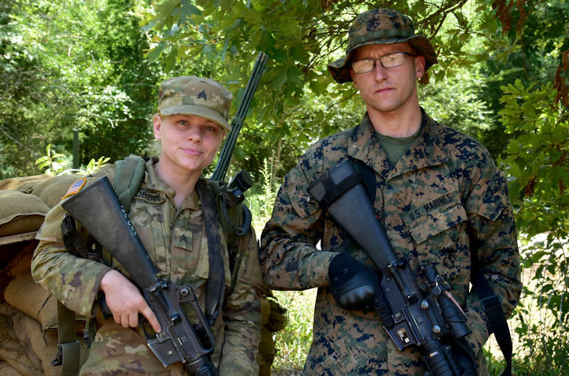U.S. Army Reserve, Army Sgt. Jessica Robbins, 2061st Multi role Bridge Company, Kentucky Army National Guard, and Lance Cpl. Dustin Wheatley, 6th Engineer Support Battalion, U.S. Marine Corps Forces Reserve, provide security from their improvised foxhole for the 489th Engineer Battalion, 420th Engineer Brigade, U.S. Army Reserve, July 21, 2018, during River Assault 2018 at Fort Chaffee in Fort Smith, Arkansas. The exercise is a joint operation bringing together elements from the Army Reserve, Army National Guard, regular Army, and the U.S. Marine Corps for engineer training to include wet cap crossings, helocast exercises, and demolitions. (U.S. Army Reserve photo by First Sgt. Daniel Griego)