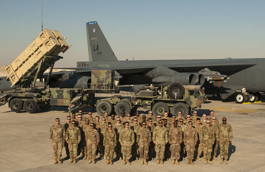 "The U.S. Army Top Notch 11th Air Defense Artillery ""Imperial"" Brigade headquarters, Task Force Spartan, poses for a photo with the assistance of the U.S. Air Force B-52 Bomber Wing at Al Udeid Air Base, Qatar on January 12, 2018. (U.S. Army photo by Staff Sgt. Johnathan Hoover)"