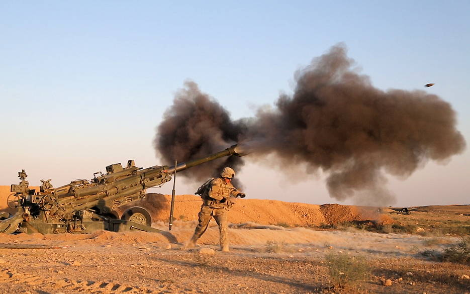 June 5, 2018 - U.S. Army Soldiers with the 3rd Cavalry Regiment fire artillery during a hot sunney day alongside Iraqi Security Force artillery at known ISIS locations near the Iraqi-Syrian border. Iraqi Security Forces and Coalition partners provided fire support to assist the Syrian Democratic Forces as they continued Operation Roundup, the military offensive to rid the final pockets of the terrorist organization from the Middle Euphrates River Valley in Syria. (U.S. Army photo by Spc. Anthony Zendejas IV)