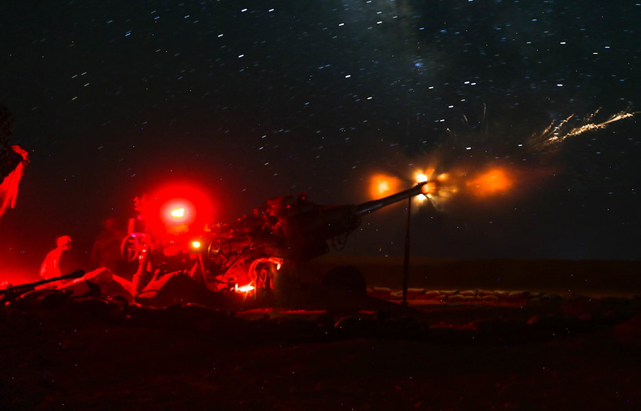 June 5, 2018 - U.S. Army Soldiers with the 3rd Cavalry Regiment light up the night sky with artillery alongside Iraqi Security Force artillery at known ISIS locations near the Iraqi-Syrian border. Iraqi Security Forces and Coalition partners provided fire support to assist the Syrian Democratic Forces as they continued Operation Roundup, the military offensive to rid the final pockets of the terrorist organization from the Middle Euphrates River Valley in Syria. (U.S. Army photo by Spc. Anthony Zendejas IV)