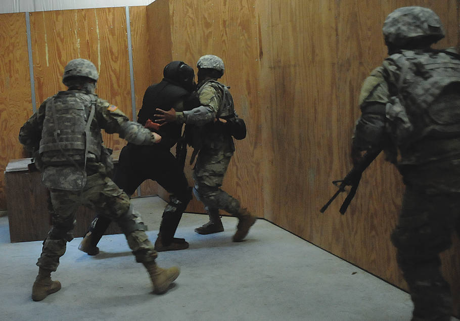 March 28, 2018 - The suspect, surrounded, launches himself toward a Soldier, as fellow teammates close in during Modern Army Combatives training at U.S. Army Garrison Fort Lee. (Photo by Terrance Bell, U.S. Army Garrison Fort Lee Public Affairs)