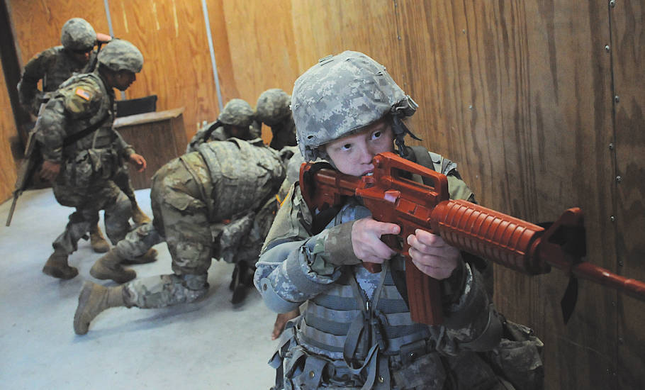 March 28, 2018 - Pvt. Tiffany Oststott, Easy Company, 16th Ordnance Battalion, provides security as her teammates wrestle the assailant to the ground during Modern Army Combatives training at U.S. Army Garrison Fort Lee. (Photo by Terrance Bell, U.S. Army Garrison Fort Lee Public Affairs)