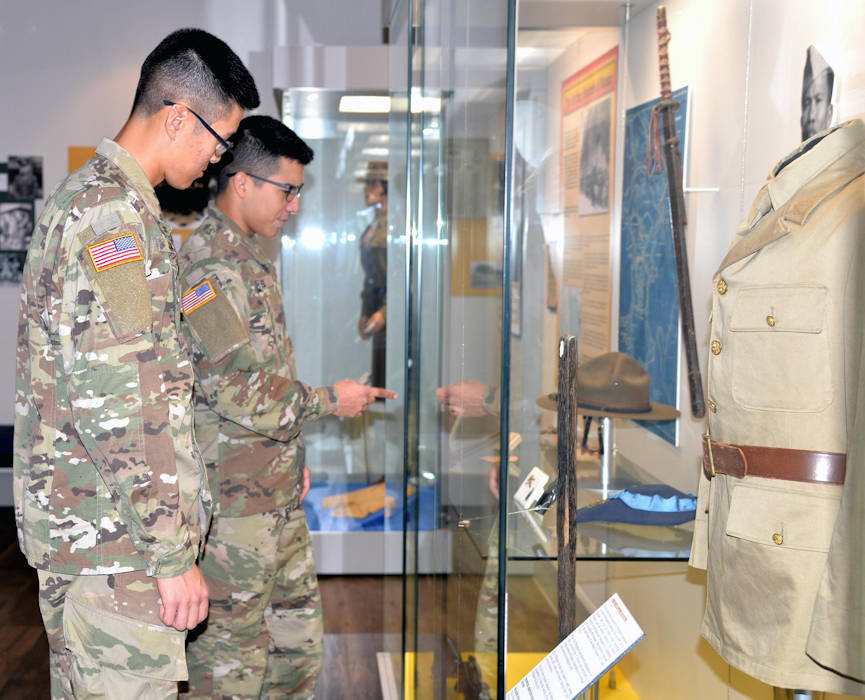 June 1, 2018 - Army Pfc. Class Min Jung (left) and Army Spc. Angel Torres (right) view a historical display at the Fort Sam Houston Museum. Located in the historic Quadrangle, the museum contains six rooms of exhibits, displays and artifacts on the history of Fort Sam Houston and a reference library and archives. (U.S. Air Force photo by David DeKunder)
