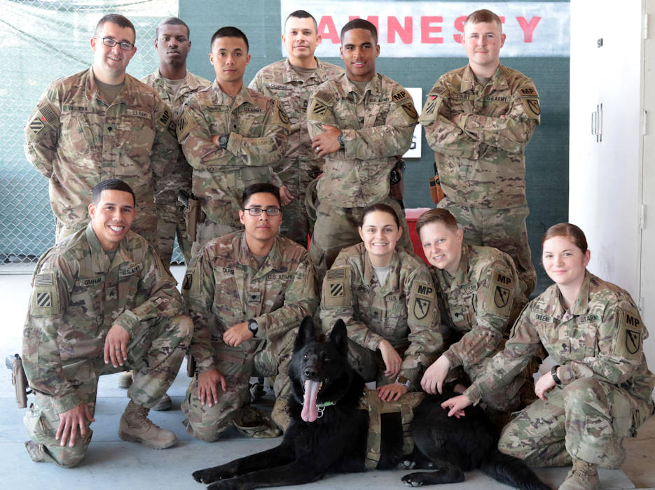 March 23, 2018 - The custom agents with the 236th Military Police Company, Special Troops Battalion, 3rd Infantry Division Resolute Support Sustainment Brigade pose with Hulk, a bomb detection dog with the American K-9 Detection Services, at the Bagram Airfield, Afghanistan customs office. The agents work with Hulk to check baggage for explosives and ensure the safety of flight crews and passengers. (U.S. Army photo by Spc. Elizabeth White)