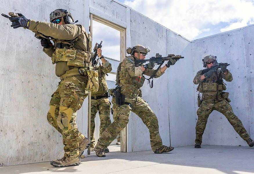 U.S. Army soldiers on conduct urban combat training involving the Every Receiver A Sensor (ERASE) program ... for a l mission to liberate and provide security for a city that is occupied by a hostile force. (U.S. Army courtesy photo)