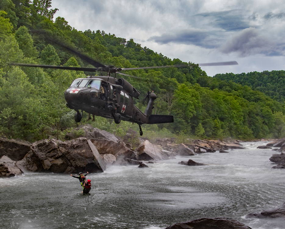 June 11, 2018 - West Virginia National Guard Soldiers with Company C 2/104th General Support Aviation Battalion (MEDEVAC) fly the West Virginia Swift Water Rescue Team as they complete Federal Emergency Management Agency (FEMA) Level One training at Camp Dawson, W.Va. The WVSWRT was developed after the devastating floods of 2016 that impacted all 55 counties of the state of West Virginia to assist citizens in a time of need. (U.S. Air National Guard photo by Airman 1st Class Caleb Vance)