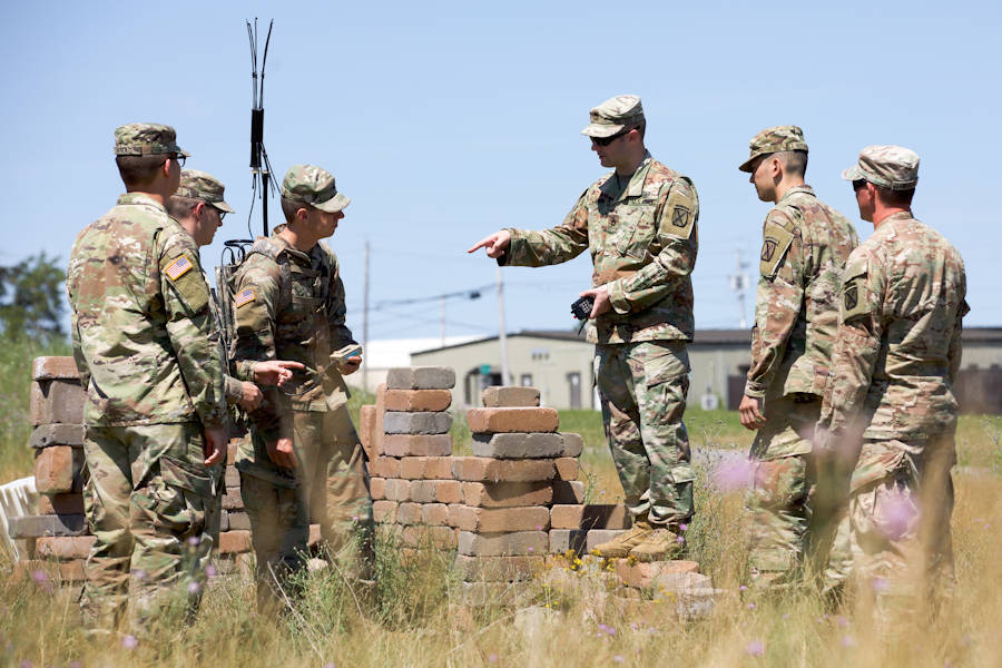 U.S. Army Sgt. 1st Class Jeremy Allen (center), an electronic warfare specialist, 1st Brigade Combat Team, 10th Mountain Division (LI), describes the functionality of the THOR III to 1BCT Soldiers during the Company Crew Specialist Course, July 11, 2018. During 1the course Soldiers learn how to electronically defeat IED's and be observant of their surroundings. (U.S. Army photo by SSG James Avery, 1BCT, 10th Mountain Div.)