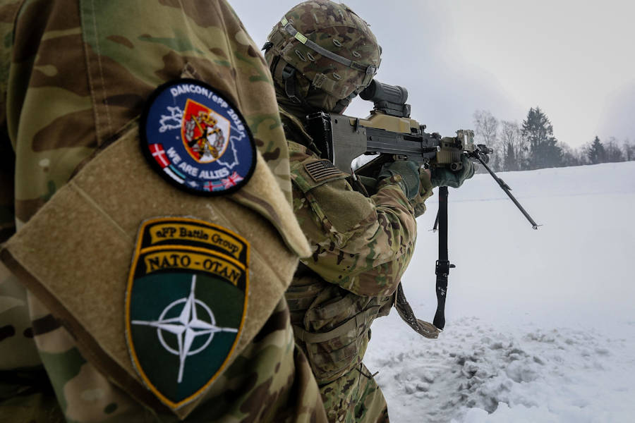 A Danish soldier (left) coaches a U.S. Army Soldier with the 82nd Brigade Engineer Battalion, 2nd Armored Brigade Combat Team, 1st Infantry Division, as he uses a Danish M60 Machine Gun during a multinational weapons training session in Tapa, Estonia, March 10, 2018 as part of a rapid response readiness exercise in support of Atlantic Resolve. (U.S. Army photo by Spc. Hubert D. Delany III, 22nd Mobile Public Affairs Detachment)