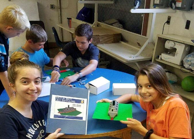 May 21, 2018 - Middle school students enjoying a free Lego educational outreach. This outreach is offered through the Hampton Roads Naval Museum's Educational Department. Museum educators visit area schools to provide a historical lesson based on the school's educational curriculum. Thereafter, students are able to build a Lego model based on the plans that are provided in a method that allows students to get their hands on history. (U.S. Navy photo by Hampton Roads Naval Museum Educator AJ Orlikoff)