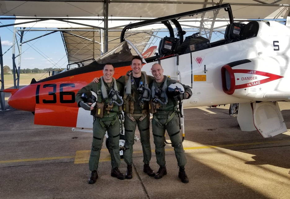 March 1, 2018 - Marine 1st Lt. Andy Occhipinti, left, and Marine Capt. Matteo Occhipinti, right, in front of a T-45C Goshawk jet trainer aircraft with their classmate, Navy Lt. j.g. Daniel Ryan, during Advanced jet training at Training Air Wing 1, Naval Air Station Meridian, Mississippi. (Courtesy photo by Matteo and Andy Occhipinti)