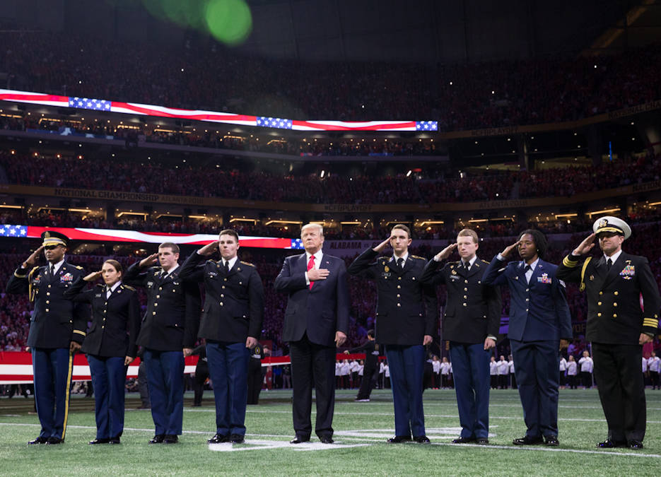January 8, 2018 - President Donald J. Trump participates in on field ceremonies at the 2018 College Football Playoff National Championship between the University of Alabama Crimson Tide and the University of Georgia Bulldogs. Alabama won the game in overtime. (Official White House Photo by Shealah Craighead)