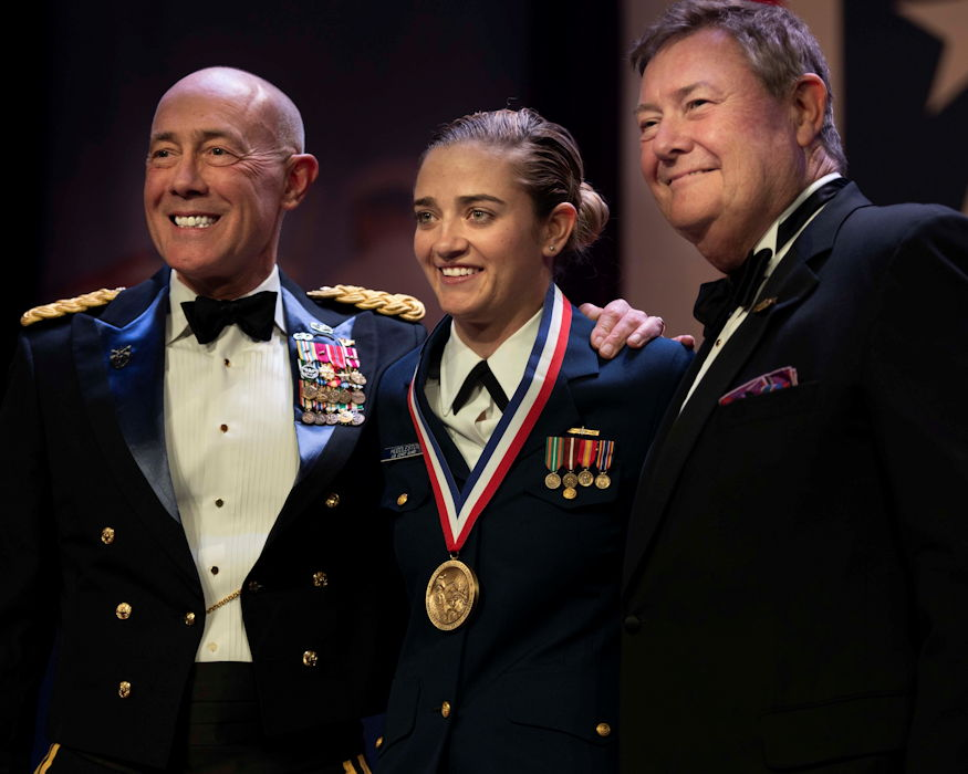 December 12, 2018 - Coast Guard Petty Officer 2nd Class Traci Huddleston (middle) smiles with Lt. Gen Charles D. Luckey, chief of Army Reserve and commanding general of U.S. Army Reserve Command (left), and Edward T. Reilly (right), the vice chairman of the United Services Organization (USO) of Metropolitan New York, after being awarded the George Van Cleve Military Leadership medal at the during the 57th USO Armed Forces Gala, held at the Manhattan Marriott Marquis, New York8. The gala is an annual event that honors the Armed Forces, civilians who volunteer their time to the military through the USO and the corporations who show their support by employing veterans and members of the Reserve forces. (U.S. Army Reserve photo by Sgt. Audrey Hayes)