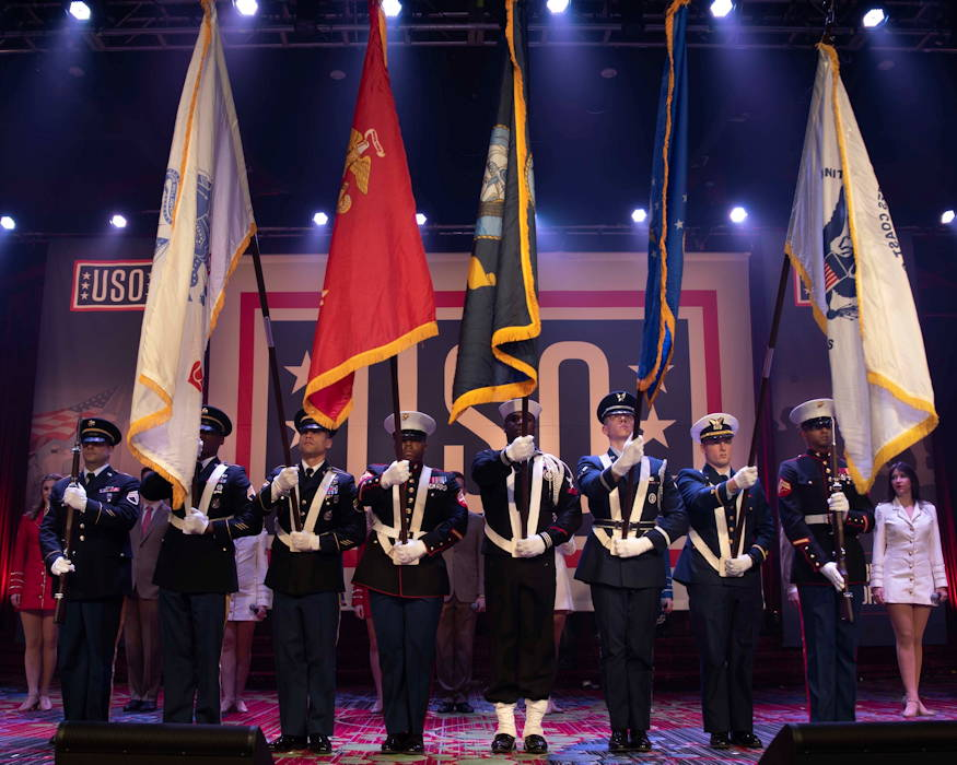 December 12, 2018 - An honor guard, comprised of service members from all branches of the Armed Forces, presents arms during the opening ceremony of the 57th United States Organization (USO) Armed Forces Gala, held at the Manhattan Marriott Marquis, New York. The gala is an annual event that honors the Armed Forces, civilians who volunteer their time to the military through the USO and the corporations who show their support by employing veterans and members of the Reserve forces. (U.S. Army Reserve photo by Sgt. Audrey Hayes)