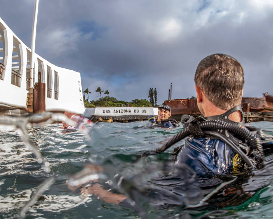 U.S. Navy divers conduct diving operations on the USS Arizona Memorial at Joint Base Pearl Harbor-Hickam, Hawaii, June 28, 2018. The divers are assigned to Mobile Diving Salvage Unit 1. (U.S. Navy photo Petty Officer 1st Class Arthurgwain L. Marquez)