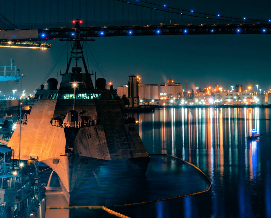 August 31, 2018 - The Independence-variant littoral combat ship USS Manchester (LCS 14) rests in the Port of Los Angeles' night glow during a scheduled visit for LA Fleet Week (LAFW). LAFW is an opportunity for the American public to meet their Navy, Marine Corps and Coast Guard teams and experience America's sea services. During fleet week, service members participate in various community service events, showcase capabilities and equipment to the community, and enjoy the hospitality of Los Angeles and its surrounding areas. (U.S. Navy photo by Mass Communication Specialist 3rd Class Andrew Langholf)