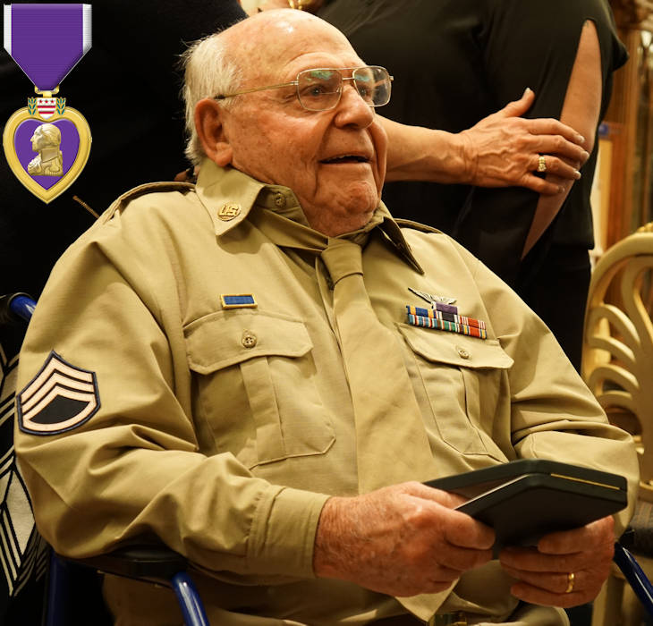 February 23, 2018 - Staff Sgt. Edward Mims, 93, smiles and holds his Purple Heart Medal as well-wishers thank him for his service following a ceremony in his honor at the The Villages, a retirement community in Florida. Mims was awarded the medal nearly 74 years after being wounded in World War II while serving as a top turret gunner on a B-24 Liberator bomber. Fort Stewart garrison command team Col. Jason Wolter and Command Sgt. Maj. Marty Conroy present the veteran his medal. (Image created by USA Patriotism! from U.S. Army photo by Kevin Larson, Fort Stewart Public Affairs Office)