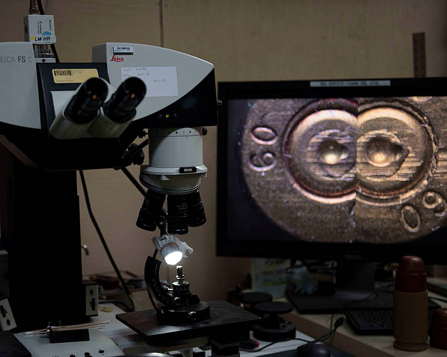 An optical bridge, two-connected microscopes, is used to match the markings on bullets at the Afghanistan Captured Material Exploitation laboratory at Bagram Airfield, Afghanistan, Jan. 3, 2019. Just like fingerprints, the markings on firearms and their components are unique to the make, model, caliber, country of origin and serial number of a specific firearm. (U.S. Air Force photo by Senior Airman Kaylee Dubois)