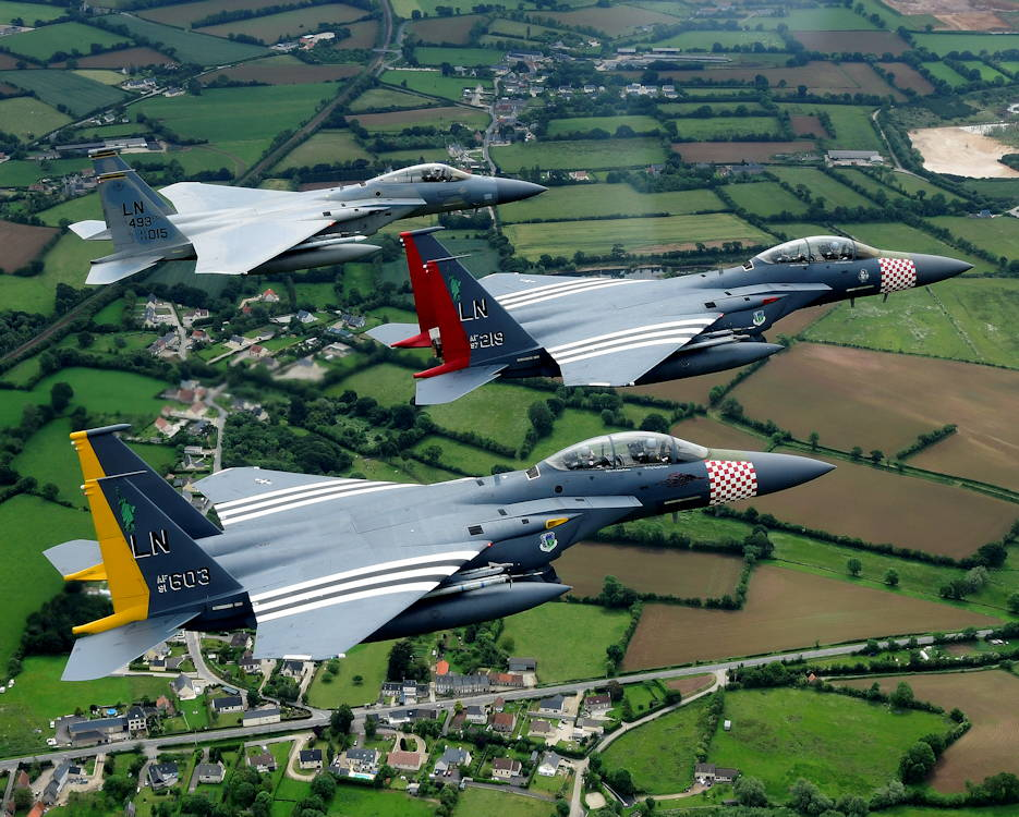 June 9, 2019 - An F-15C Eagle and a pair of heritage painted F-15E Strike Eagles assigned to the U.S. Air Force 48th Fighter Wing conduct a flypast over Normandy, France in support of the 75th anniversary of D-Day. An epic multinational operation, D-Day forged partnerships and reinforces trans-Atlantic bonds that remain to this day. (U.S. Air Force photo by Tech. Sgt. Matthew Plew)