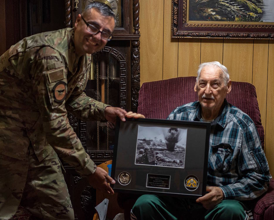 December 23, 2019 - Retired U.S. Air Force Staff Sergeant Dennis Provencher, airborne and ground radio operator, right, receives a memento from Lt. Col. Daniel Waid, 18th Communications Squadron commander, left, for his years of dedicated service in Okinawa City, Okinawa. Provencher served 20 years in the military and continued to serve after retirement in his community and donating blood every two months. (U.S. Air Force Photo by Airman 1st Class Rebeckah Medeiros)