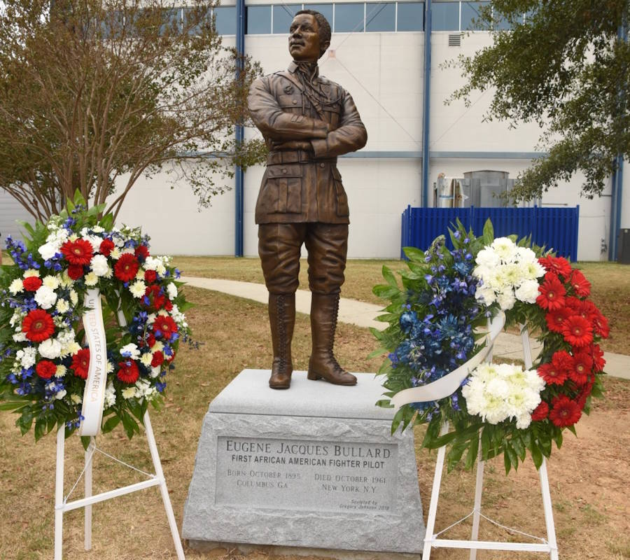 October 9, 2019 - Two wreaths stand beside a statue of 2nd Lt. Eugene Jacques Bullard, the first African American fighter pilot, who flew combat flights in World War I and was known as ... The Black Swallow of Death. The wreaths were placed during a ceremony at the Museum of Aviation, Warner Robins Georgia. Bullard, who was from Columbus, Georgia, was a forefather to the pilots known as The Tuskegee Airmen. (Image created by USA Patriotism! from U.S. Air Force photo by Tommie Horton)