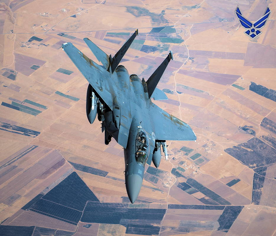 September 24, 2019 - A U.S. Air Force F-15E Strike Eagle conducts a combat air patrol mission over an undisclosed location in Southwest Asia. The Strike Eagle plays a key role in Air Force Central Command operations by maintaining constant readiness in support of air operations, providing deterrence and stability, and bolstering the mission efforts of coalition partners. (Image created by USA Patriotism! from U.S. Air Force photo by Master Sgt. Russ Scalf)