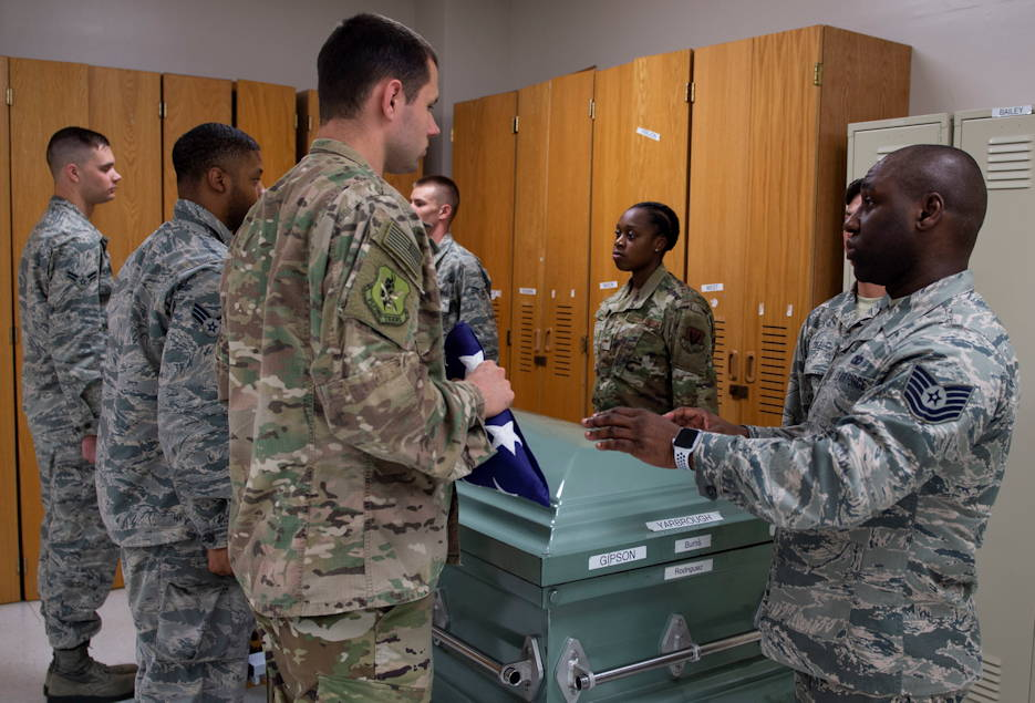 Tech. Sgt. Jesse Larson, left, NCO in charge (NCOIC) of Honor Guard, hands the flag to Tech. Sgt. Jamaal Smalls, NCOIC of Honor Guard, during six-person flag-fold training, July 25, 2019, at Moody Air Force Base, Georgia. (U.S. Air Force photo by Airman Azaria Foster)
