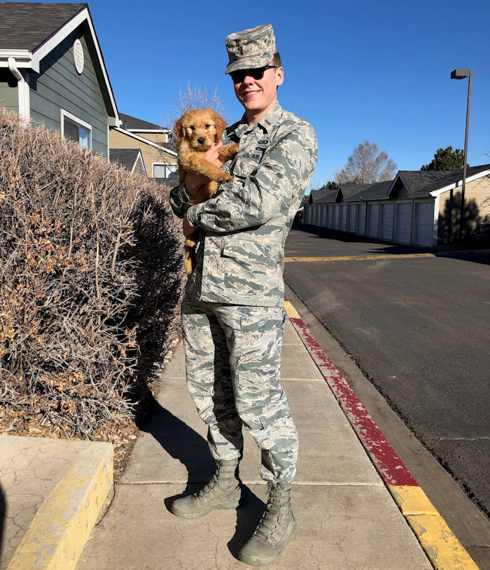 U.S. Air Force 2nd Lt. Justin Davidson-Beebe, 21st Space Wing public affairs officer, with his dog Butters on March 20, 2019 at Colorado Springs, Colorado. He feels that Butters and the other dogs he had through his life help him maintain his resilience, because of their innate enthusiasm. (U.S. Air Force photo courtesy 2nd Lt. Justin Davidson-Beebe)