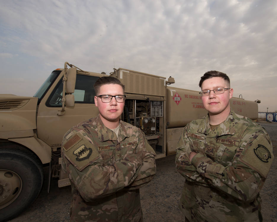 February 23, 2019 - Senior Airmen Jeffrey and Joshua Young, 407th Expeditionary Logistics Readiness Squadron fuels distribution operators stand in front of an R-11 fuel truck at Ahmed Al Jaber Air Base, Kuwait. Day and night, there is a Young brother fueling the fight against ISIS. (U.S. Air Force photo by Tech. Sgt. Clinton Atkins)