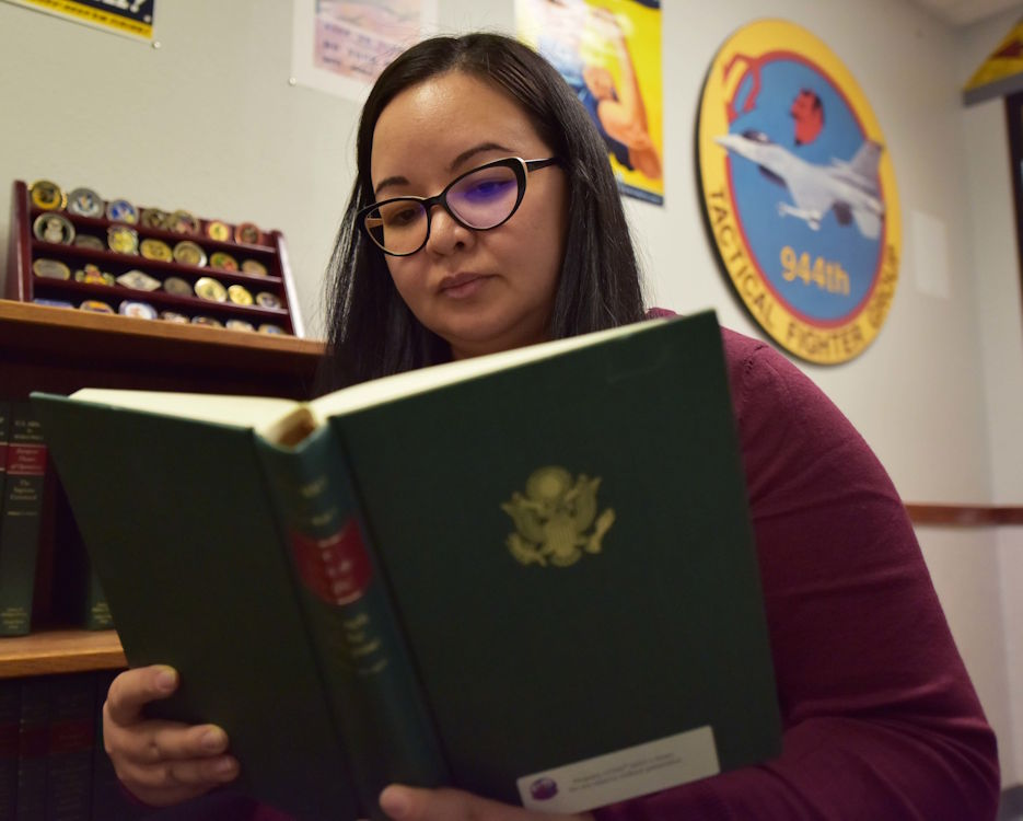 October 24, 2019 Jessica Johnson, 944th Fighter Wing historian, reads a military history book at Luke Air Force Base, Ariz. Johnson is the wing's first fulltime historian whose primary responsibility is to advise the commander and his staff on historical issues as they pertain to current decision making. (U.S. Air Force photo by Tech. Sgt. Louis Vega Jr.)