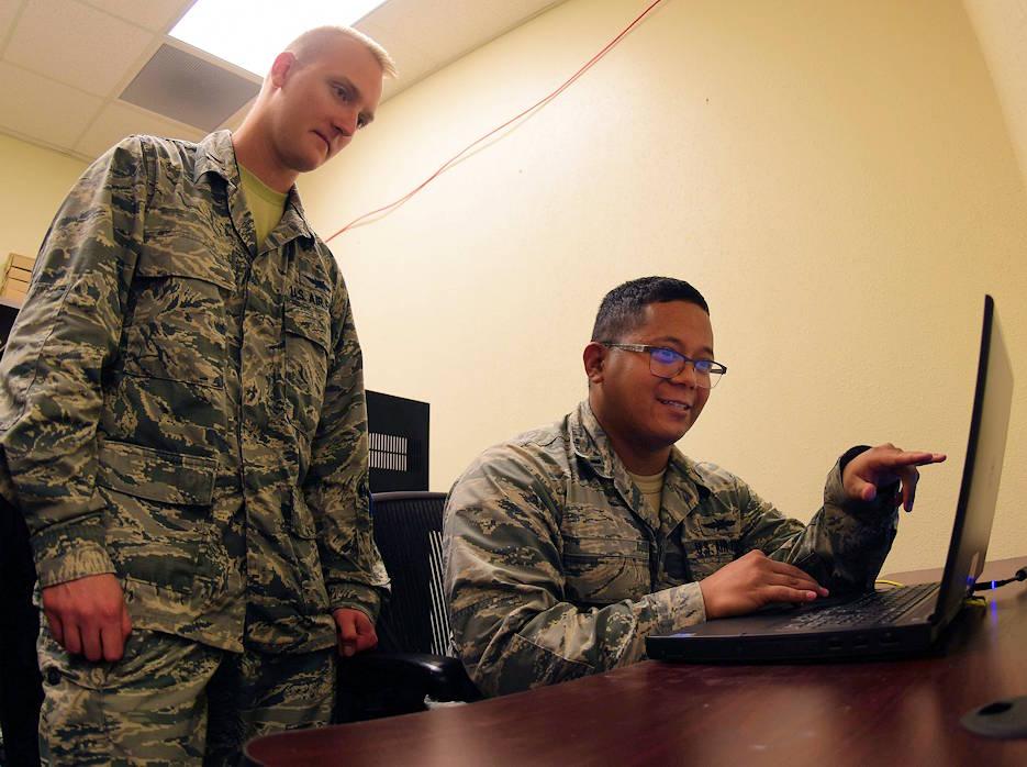 1st Lt. Vaughn, 432nd Aircraft Communications Maintenance Squadron Mission Defense Team officer in charge, and 2nd Lt. Eric, 432nd ACMS MDT Assistant officer in charge, go over computer code at Creech Air Force Base, Nevada on April 29, 2019. The 432nd Wing's MDT is tasked with assuring the integrity of the MQ-9 Reaper's cyber networks and protecting the support equipment that connect the aircraft to the cockpits on the ground. (U.S. Air Force photo by Airman 1st Class Haley Stevens)