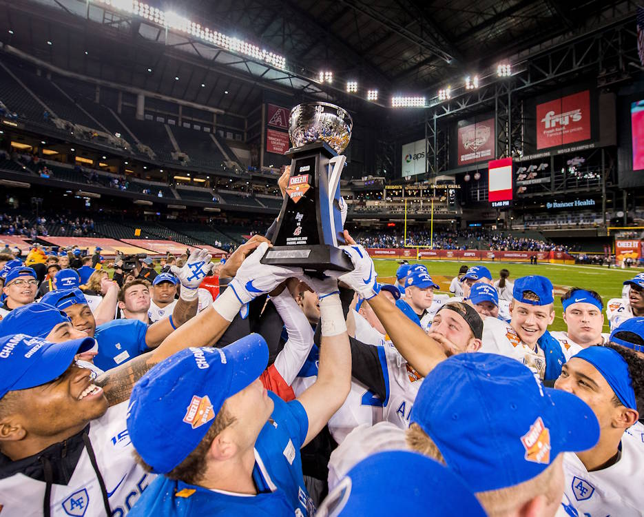 December 27, 2019 - Air Force Academy football players hold up the Cheez-It Bowl championship trophy on after defeating Washington State University at Chase Field in Phoenix, Arizona. Air Force defeated Washington State 31-21 to finish their season with an 11-2 record with an eight game win streak making it the third best season in program history. (U.S. Air Force photo by Trevor Cokley)