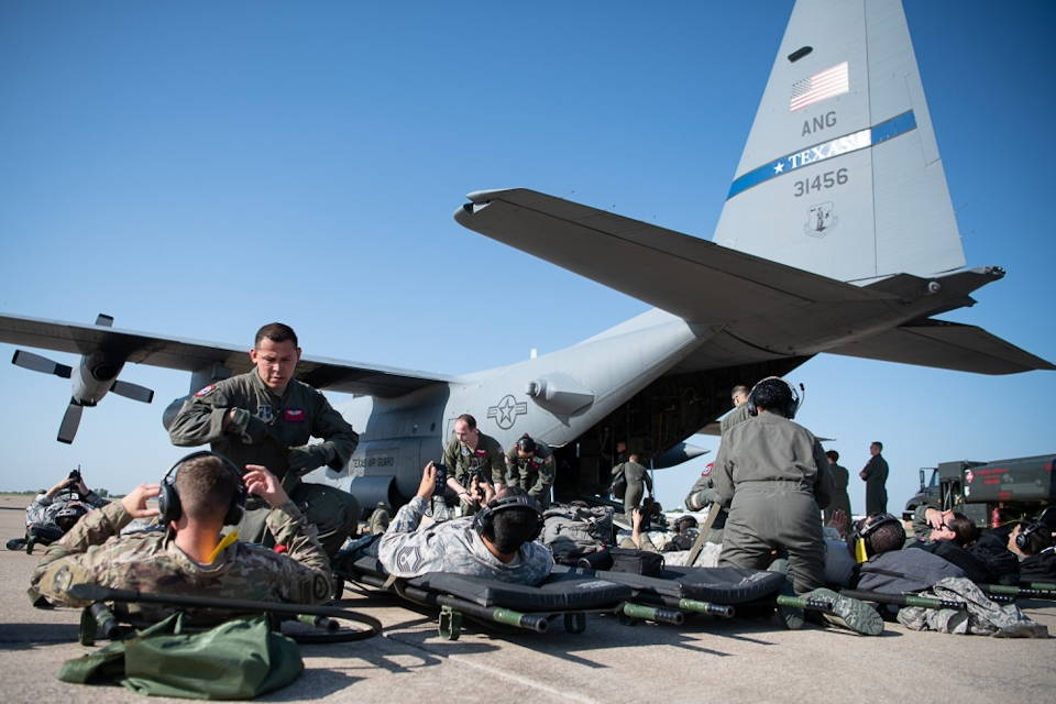 August 21, 2019 - Oklahoma Air National Guard aircrews assigned to the 137th Aeromedical Evacuation Squadron out of Will Rogers Air National Guard Base in Oklahoma City prepare litter patients to be loaded onto a Texas Air National Guard C-130 Hercules assigned to the 136th Airlift Wing out of Carswell, Texas, before taking off toward the U.S. Virgin Island of St. Croix from Will Rogers during a training mission. (U.S. Air National Guard photo by Tech. Sgt. Kasey M. Phipps)