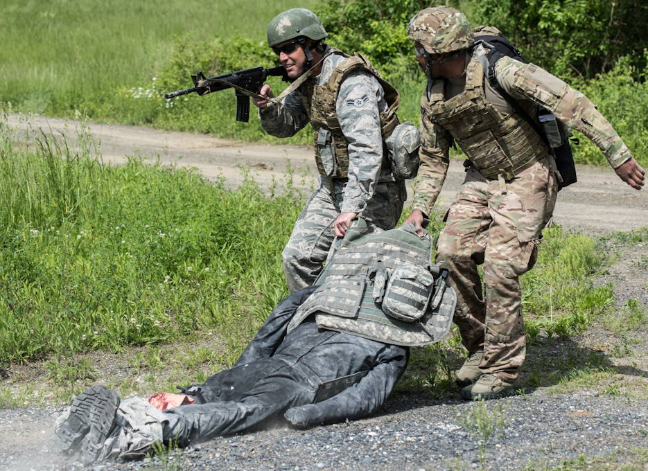 May 21, 2019 - U.S. Airmen from the 193rd Special Operations Medical Group Detachment 1, Pennsylvania Air National Guard, move a casualty to cover during Tactical Combat Casualty Care training at Annville, Pennsylvania. The TCCC training was a two-day training event that provided Airmen with the fundamentals of treating and evacuating casualties in a combat environment. (U.S. Air National Guard photo by Staff Sgt. Tony Harp)
