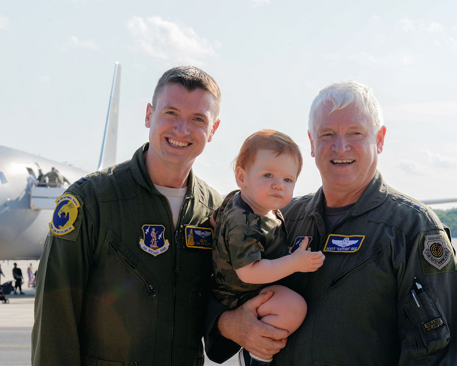August 8, 2019 - Lt. Gen. L. Scott Rice, director of the Air National Guard, with his son, Capt. Leon Rice, a pilot assigned to the 157th Air Refueling Wing, and his grandson in front of the new KC-46A Pegasus air refueling tanker during a welcome ceremony held at Pease Air National Guard Base, N.H. The tanker's arrival marked the final flight of the general's career. (U.S. Air National Guard photo by Senior Airman Victoria Nelson)