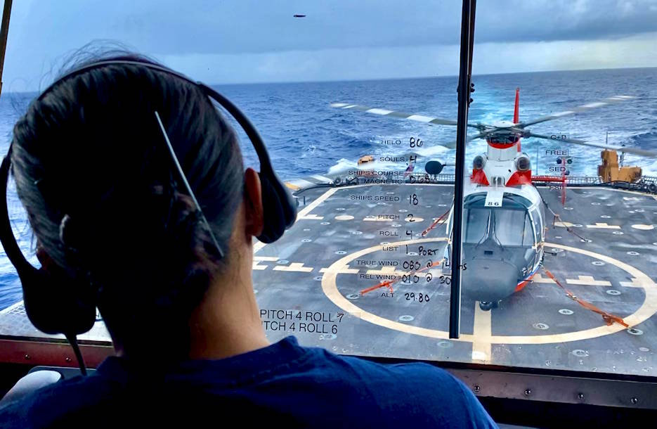 November 1, 2019 - Lt. j.g. Angela-Ruth Johnson, the assistant operations officer on USCGC Stratton (WMSL 752), serves as the break-in helicopter operations officer overseeing the evolution of a helicopter operation from the bridge of the ship. (U.S. Coast Guard photo by Chief Petty Officer Sara Muir)