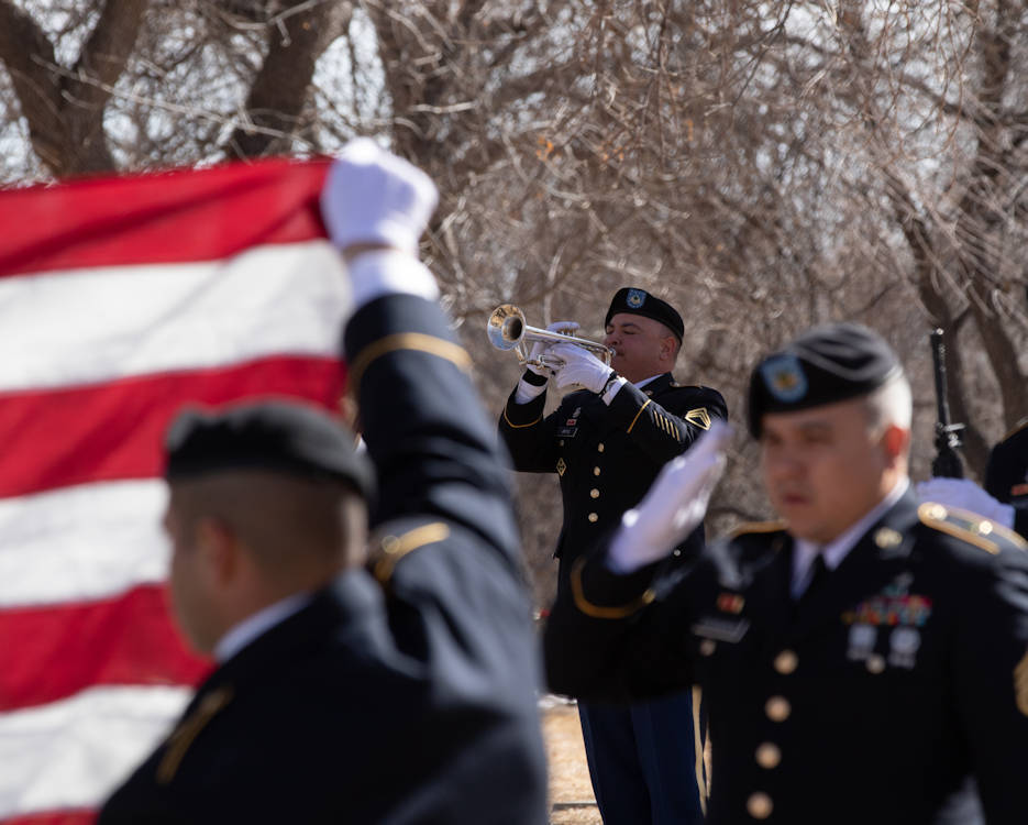 Staff Sgt. Luis Ortiz, a musician assigned to the 4th Infantry Division Band, performs Taps during a full military honors service Feb. 12, 2019, at Evergreen Cemetery, Colorado Springs, Colorado. The service was held in honor of Maynard Miller, an Army veteran who served in Vietnam and the Korean Conflict. (U.S Army photo by Pfc. Matthew Rabahy)