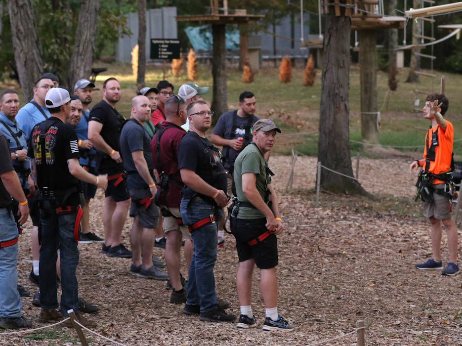 September 27. 2019 - Veterans of B Company, 2nd Battalion, 504th Parachute Infantry Regiment, 82nd Airborne Division, Fort Bragg, North Carolina, receive instruction on proper climbing and zip lining at The Adventure Park during a unit reunion, organized with the help of the Independence Fund, in Nashville, Tennessee. The purpose of the weekend was to reunite the Soldiers of B Company, 2/504, rebuild lost relationships and build new ones in order to establish the relationship veterans need for life support when they need someone to talk too who will understand their language and can relate to the experiences they've had while serving in the military. (U.S. Army photo by Staff Sergeant Michael Eaddy)