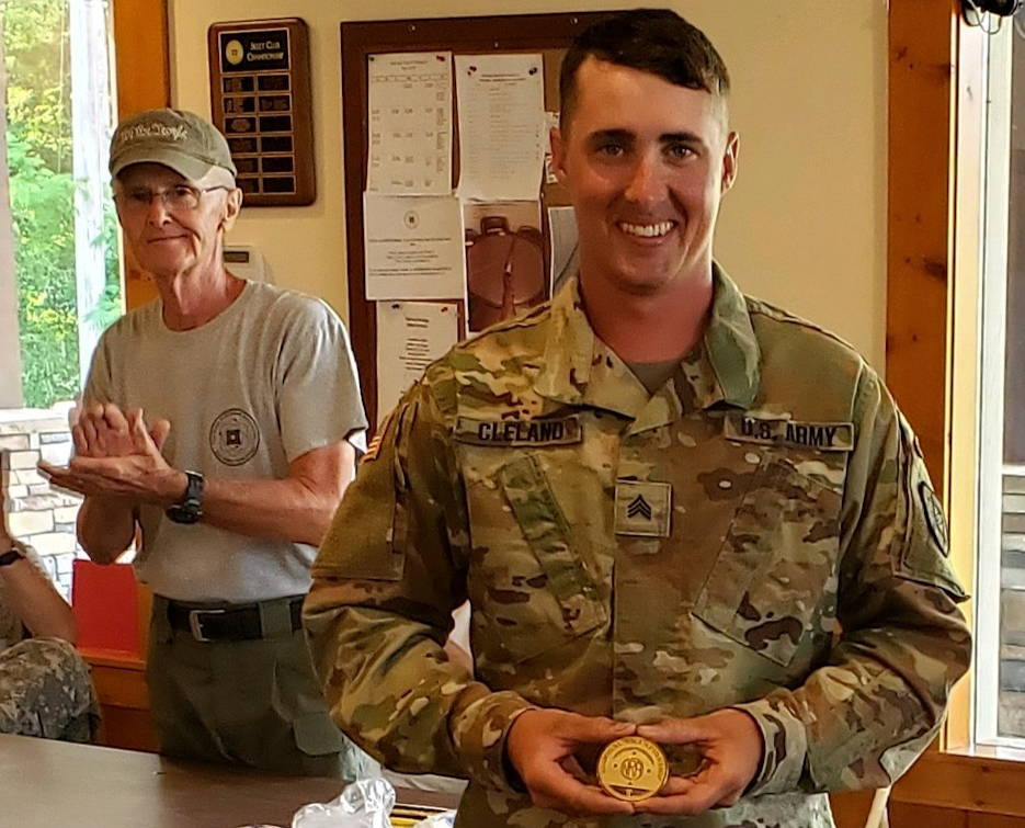 U.S. Army Sgt. Benjamin Cleland with his first place medal after setting a new national record by shooting the first-ever, perfect score of 800 with a service rifle while wining the 2019 Charlie Smart Memorial Regional in Oak Ridge, Tennessee on June 2, 2019. (U.S. Army photo by Maj. Michelle Lunato)