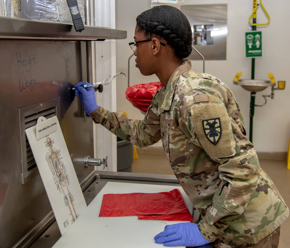 April 2, 2019 - U.S. Army Spc. Kellysha Fahn, 54th Quartermaster Company mortuary affairs specialist, prepares information for an upcoming mission at the Armed Forces Medical Examiner System, Dover Air Force Base, Delaware. Fahn originally chose the mortuary affairs specialist, or 92M, military occupation because it doesn't confine her to a desk while testing her abilities. (U.S. Air Force photo by Staff Sgt. Nicole Leidholm)