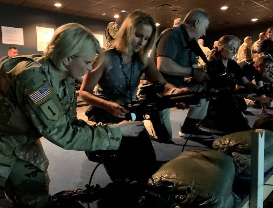 April 24, 2019 - Col. Dina Wandler, brigade commander, U.S. Army 1st Recruiting Brigade, assists Melissa Friez, assistant superintendent of student support services, Pittsburgh Public Schools, with the M4 Rifle simulator while visiting the Engagement Skills Trainer on U.S. Army Recruiting Command's National Educator Tour at Fort Benning, Georgia. (U.S. Army photo by April Michelle deGuzman-Watson)
